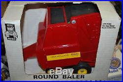 1/16 New Holland 660 round baler, older toy, new in the box, very nice