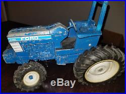 Ertl Ford 7710 116 Die-cast Toy Tractor with Ertl New Holland 116 Hay Baler