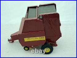 Ertl Scale Models 1/16 New Holland 660 Round Auto Baler With Bale Near Mint